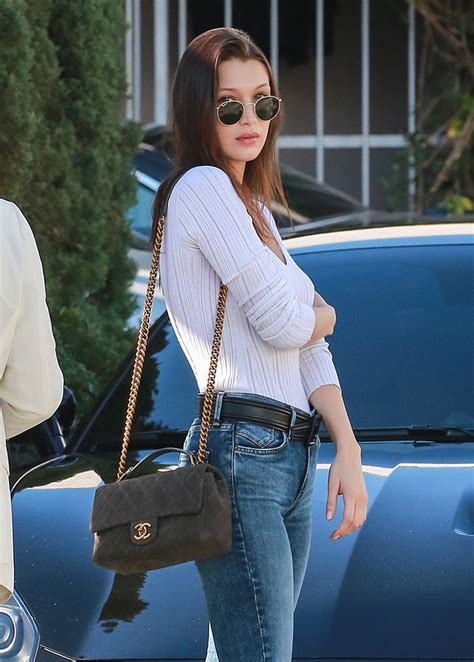 Celebs Holiday Shop While Carrying Bags from Chanel