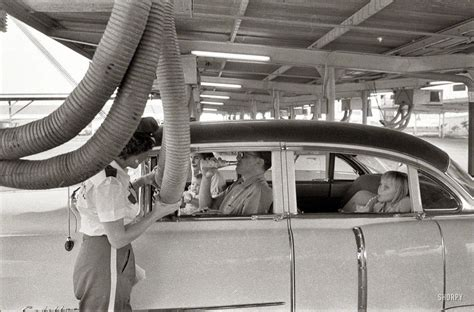 A family at a drive-in restaurant having cool air piped